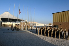Airmen from the honor guard and the 379th Expeditionary Medical Group perform a retreat ceremony in 2006