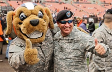 Browns mascot Chomps (shown greeting U.S. National Guard members at FirstEnergy Stadium.)
