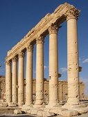 These are composed of stacked segments and finished in the Corinthian style (Temple of Bel, Syria)