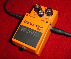 A Boss distortion pedal in use