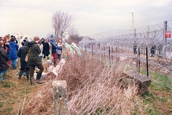 Demonstrators outside the wire fences