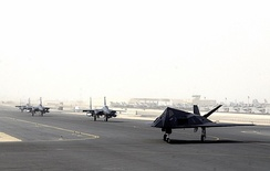 An F-117 and F-15s prepare to launce from Al Udeid Air Base, Qatar, during Operation Enduring Freedom