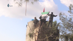 TFSA fighters hoist the Turkish flag and the Syrian independence flag on the top of Barsaya mountain.[159]