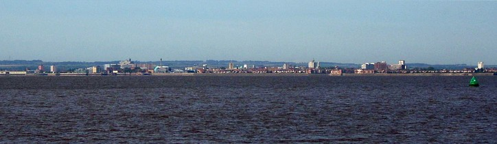 Panorama of Hull from further along the north bank of the Humber near Paull, with the Yorkshire Wolds rising behind the city