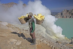 A man carrying sulfur blocks from Kawah Ijen, a volcano in East Java, Indonesia, 2009