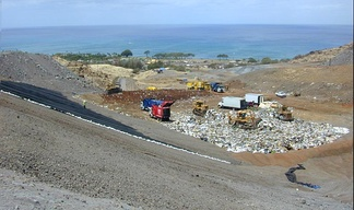 A landfill cell showing a rubberized liner in place on the left.