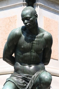 One of the four chained slaves depicted at the bottom of the 17th-century Monument of the Four Moors in Livorno, Italy.