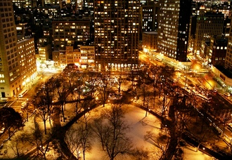 Snow-covered Madison Square Park at night, looking south (December 2005)