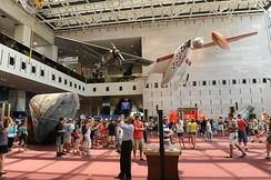 The Milestones of Flight entrance hall of the National Air and Space Museum in Washington, DC. Among the visible aircraft are Spirit of St. Louis, the Apollo 11 Command Module Columbia, SpaceShipOne, the Bell X-1, and (far right) John Glenn's Friendship 7 capsule.