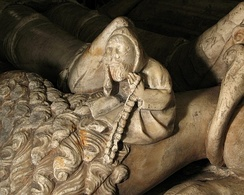 A bedesman carved on the tomb of Ralph Fitzherbert[1] who died in 1483