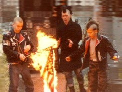 Punks burning a U.S. flag in the early 1980s