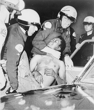 Police arrest a man during the riots on August 12.