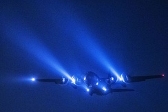 A C-130 conducts a night flight mission over Yokota Air Base