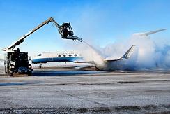 Aircraft deicing. Excess deicing fluid may contaminate nearby water bodies, if not properly recovered.