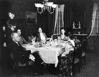 Around the table in the original 1933 Broadway production of Ah, Wilderness! are (from left) George M. Cohan (Nat Miller), Eda Heinemann (Lily), Elisha Cook, Jr. (Richard), Gene Lockhart (Sid), Marjorie Marquis (Mrs. Nat Miller), Walter Vonnegut, Jr. (Tommy) and Adelaide Bean (Mildred).