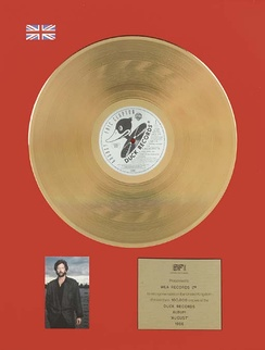 A gold certification for Eric Clapton's album August.