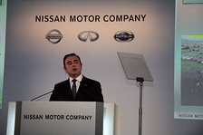 Carlos Ghosn in front of new CI at the 2013 earnings press conference in Yokohama.