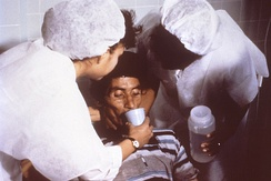 A person consuming oral rehydration solution