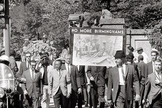 "Congress of Racial Equality march in Washington DC on 22 September 1963 in memory of the children killed in the Birmingham bombings. The banner, which says ""No more Birminghams"", shows a picture of the aftermath of the bombing."