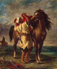 A Moroccan with his Arabian horse along the Barbary coast.