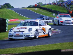 Jake Rosenzweig goes through Knickerbrook corner at Oulton Park during a Porsche Carrera Cup race.