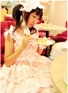 A girl eating a cake