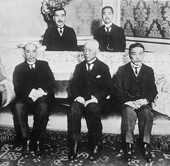 The Japanese delegation at the Conference, with (seated left to right) former Foreign Minister Baron Makino Nobuaki, former Prime Minister Marquis Saionji Kinmochi, and Japanese Ambassador to Great Britain Viscount Chinda Sutemi