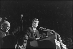 John F. Kennedy (center), Lieutenant Governor Karl Rolvaag (left), and Walter Mondale (below and between them) at the Fairground Coliseum, 1962