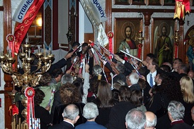 People receiving the Holy Light at Easter from Father Diogenis at St George Greek Orthodox Church Adelaide
