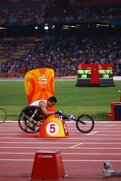 Competitor in a wheelchair race at the 2008 Summer Paralympics.