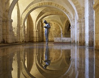 Sound II, statue by Antony Gormley in the flooded crypt