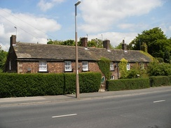Rustic, brick-built cottages in Town Street known as Top of the town were built for the Brandlings' workers.
