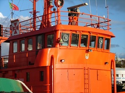 Wheelhouse on a tugboat, topped with a flying bridge.