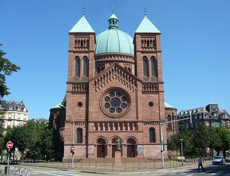 The facade of Catholic church of Saint-Pierre-le-Jeune, Strasbourg (built 1888–1893), is of a type adopted for many churches in the early 20th century.