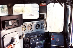 Engineer's controls in a diesel–electric locomotive cab. The lever near bottom-centre is the throttle and the lever visible at bottom left is the automatic brake valve control.