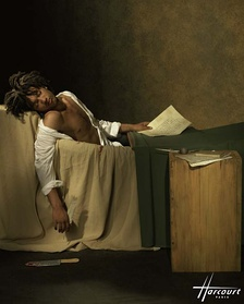 Doc Gynéco in 1997. The photo by Studio Harcourt alludes to the 1793 painting The Death of Marat.