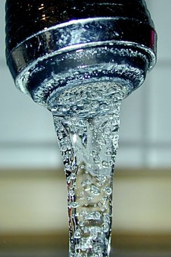 Water from a tap - supplied by a pipe
