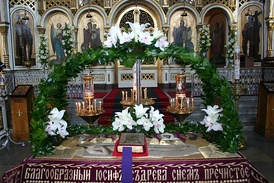 The Epitaphios (Plashchanitza) placed in the nave of the church for the faithful to venerate. The Gospel Book rests in the center.