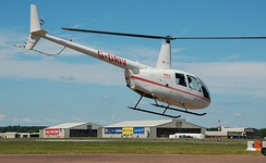 A Robinson R44 Raven II arrives for the 2014 Royal International Air Tattoo, England
