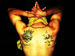 Latin Kings gang member showing his gang tattoo