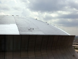 Contractors repair the roof to prepare for the reopening of the Superdome. (July 10, 2006)