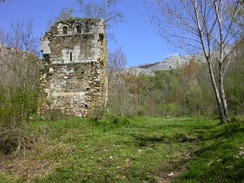 Ruins of the Monastery of San Román de Entrepeñas. The fortified tower, sole vestige of its former splendor, can be seen in the image.