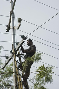A man working on powerlines in Nauru (2007)