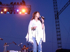 Tillis singing at the 2006 Missouri State Fair, where she opened the show for George Jones.