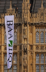 Plane Stupid activists on the roof of the Palace of Westminster
