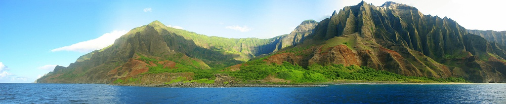 view of the Nā Pali coastline from the ocean. It is part of the Nā Pali Coast State Park which encompasses 6,175 acres (20 km2) of land and is located on the northwest side of Kauaʻii.