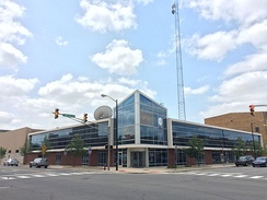WNIT Center for Public Media in downtown South Bend. The building is made primarily of glass, and has a large screen displaying the live broadcast of WNIT's public television channel.