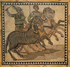 Ancient Roman mosaic of the winner of a chariot race, wearing the colors of the red team.