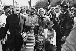 Ralph David Abernathy and his wife Juanita Abernathy follow with Dr. Martin Luther King and his wife Coretta Scott King as the Abernathy children march on the front line, leading the Selma to Montgomery March in 1965.