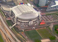 The Johan Cruyff Arena with the retractable roof opened and closed